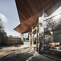 Barton House architectuiral facetted wood and glass