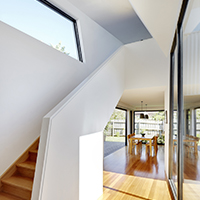 Yarra House sculptural staircase white interior with gentle angles and garden views